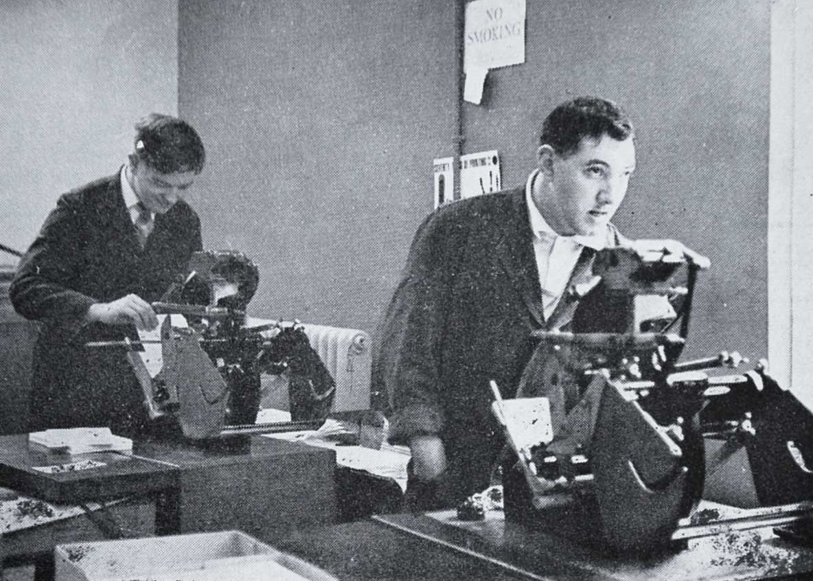 Richard Paton and Brian Nicholls at their machines in the printing shop 1964
