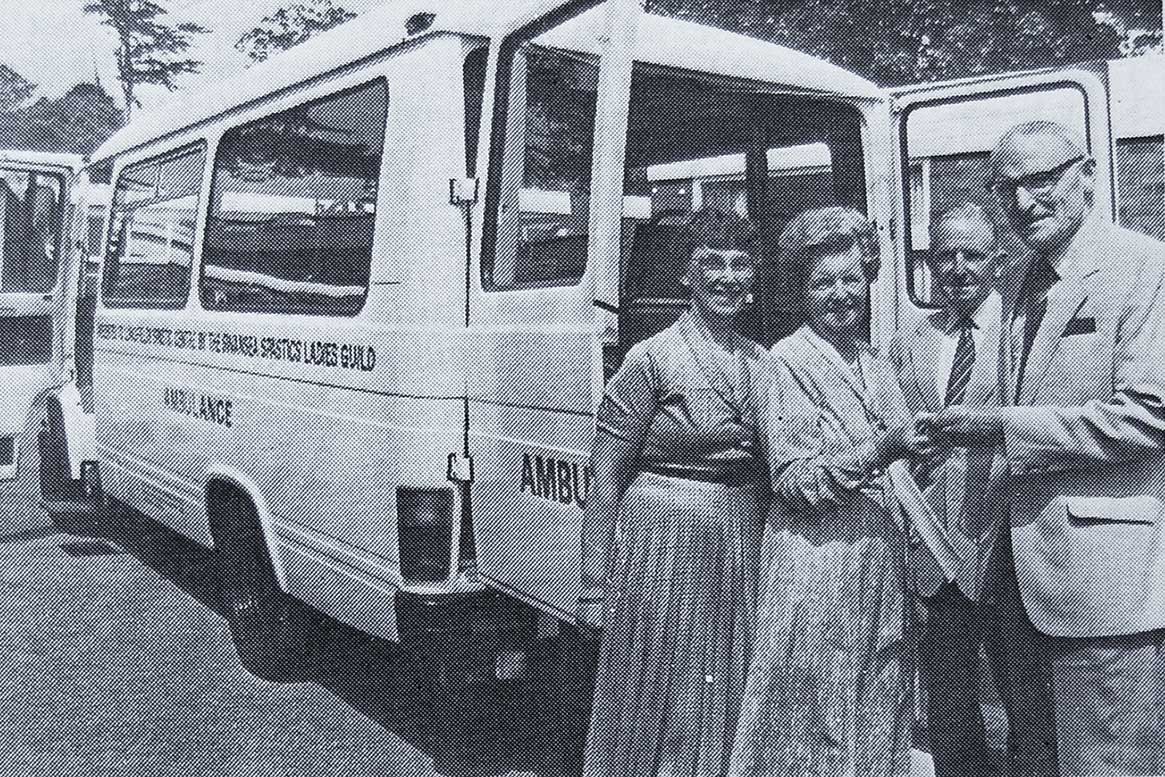 Mrs Gwen Davies, Chairman of the Ladies' Guild hands over the keys of the 17-seater Mercedes Benz ambulance to Mr Owen Lewis, Chairman of the Association. Looking on are Mrs Joan Owen, Hon. Treasurer of the Guild and Mr Harold Austin, Hon. Treasurer of the Association.